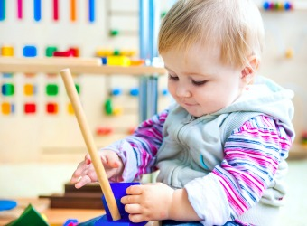 Toddler Playing in Montessori Classroom